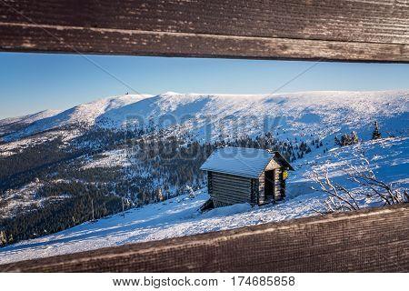 Small wooden hut on the slope of Szrenica mountain in Szklarska Poreba, Karkonosze mountains, Poland
