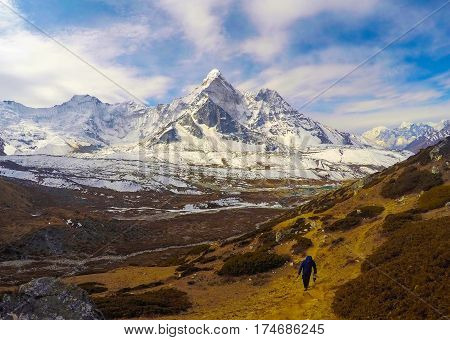 Mountain landscape of Nepal National Park. Nepalese people and severe nature. Icy and snowy peak of Kala Pattar. Himalaya trekking and mountaineering card or banner template. Sagarmatha sanctuary