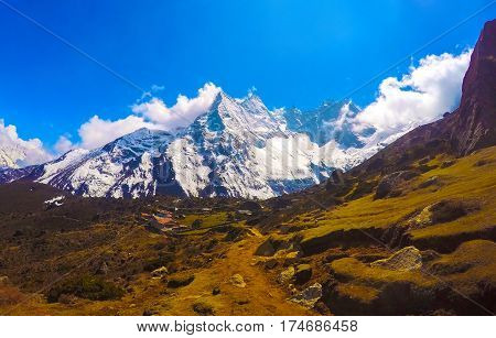 Mountain landscape of Nepal National Park. Nepalese people and severe nature. Icy snowy peak of Kala Patthar. Himalaya trekking and mountaineering card or banner template. Path to Everest base camp