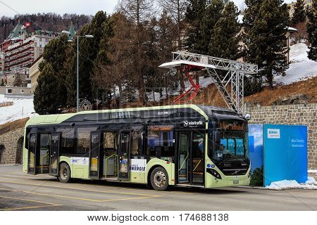 St. Moritz, Switzerland - 3 March, 2017: a Volvo 7900 Electric Hybrid bus at the quick-charge facility on Bahnhofplatz square. Buses of this type use electrical power coming from accumulators in the normal operation mode.