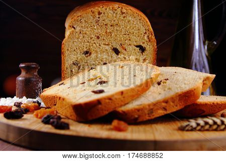 homemade white sweet bread with raisins and ears of wheat