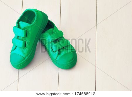 Cute baby's shoes on a white background