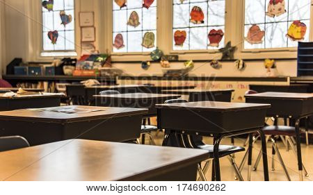Back to school, School classroom with empty school chairs and tables, classroom without students, School supplies on blackboard, School of Schoolchild and student education. classroom concept