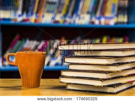 books on the table in the library, old books on table with blurry background of bookshelves, university bookstore, Stack Of Old Books in the library, Stacked Books, library concept,
