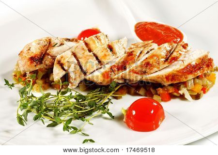 Fillet of Chicken with Vegetables and Cherry Tomato and Spicy Sauce