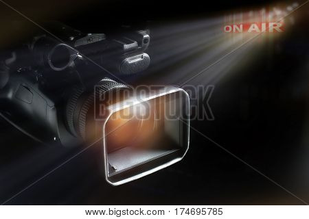 professional video camcorder in studio with on-air light background.