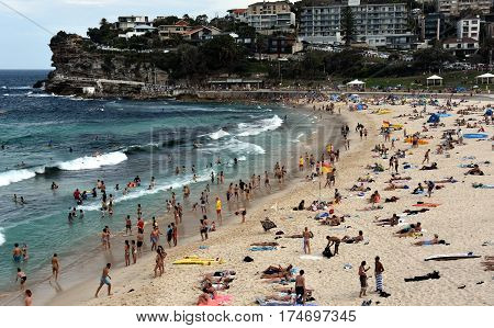 Sydney Australia - Feb 5 2017. People relaxing swimming and sun bathing on Bronte beach.