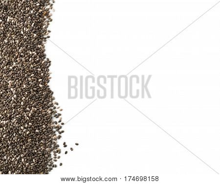 Raw unprocessed whole dried black chia seed border on white background