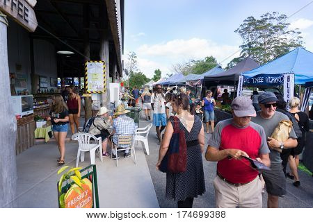 Kerikeri, New Zealand - February 11, 2017; Old Packhouse Market stalls and people wandering amongst vendors stalls and food sellers Kerikeri New Zealand.