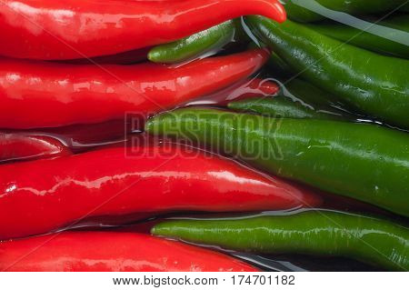 Red and green Chili Peppers on water Abstract