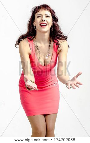 Girl red-haired actress in a beautiful cocktail dress with open shoulders