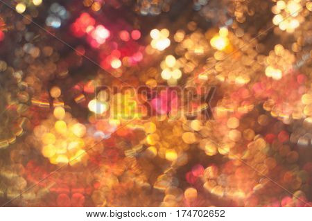 Abstract blurred of colorful lights in bokeh Christmas background and disco