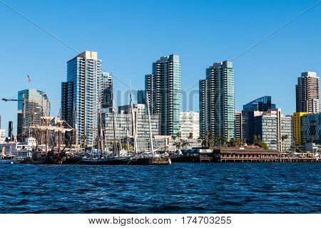 SAN DIEGO, CALIFORNIA - MARCH 2, 2017:  Tall ships at the Maritime Museum of San Diego and the downtown city skyline.
