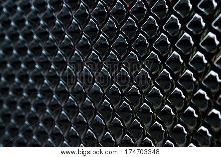 black shiny dragon scales abstract close up