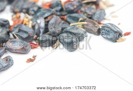 black dry barberry spice. Isolated on white background