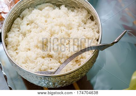 cooked rice in the traditional Thai silver ware with no body