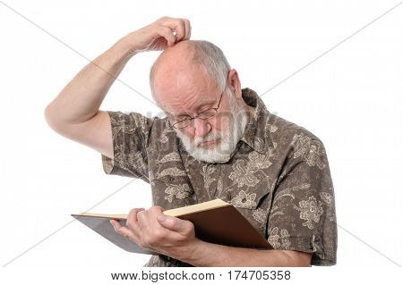 Handsome bald and bearded senior man in yeyeglasses reading a book, scratching his head. isolated on white background