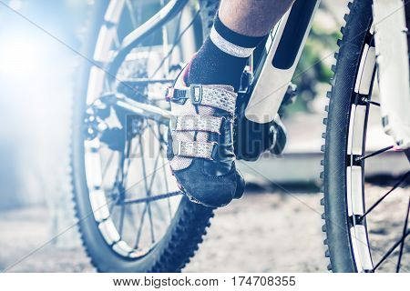 close up foot on pedal of bicycle bicycle sport concept