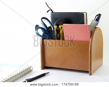 desk organizer with office supplies on white background, office equipment that allows a tidy desk