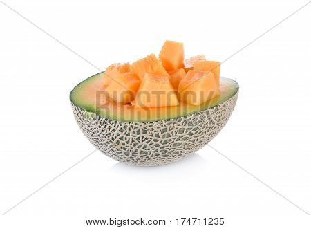 half and cube cut ripe cantaloupe on a white background