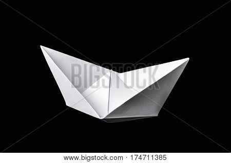 Origami Boat Isolated On Black Background