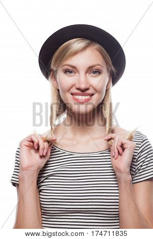 Closeup fashion studio portrait of hipster young smiling woman in black hat and striped shirt isolated over white background