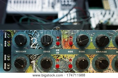 Toned image of a modern electronic synthesizer or effect processor cropped closeup