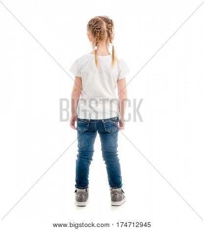 Small child standing with her back turned, wearing white t-shirt and blue jeans, isolated