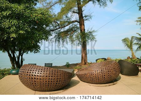 Chill out and admire the blue sea on beachfront terrace, Thailand