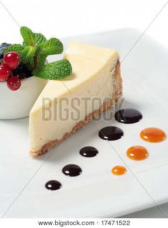 Cheese Cake with Fresh Berries Bowl and Green Mint. Isolated on White Background