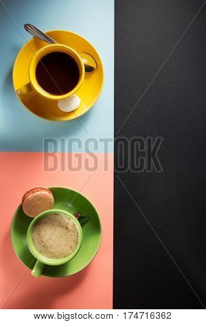 cup of coffee and cacao at colorful paper background