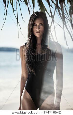 Young brunette beauty resting on the beach