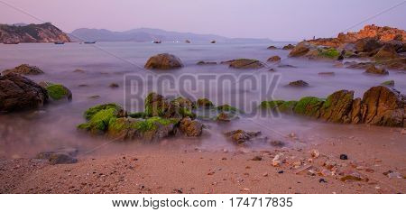 A rocky coastline beach with a beautiful view in Vung Lam Bay Vietnam.