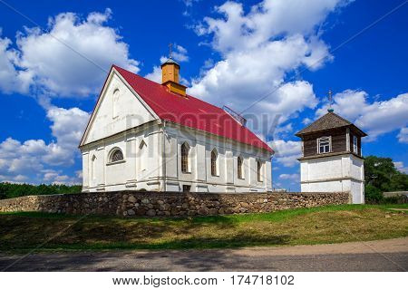 Church of the Assumption of the Blessed Virgin Mary on a background of blue sky with clouds old architecture religious places Belarus Village Pleban Molodechno District