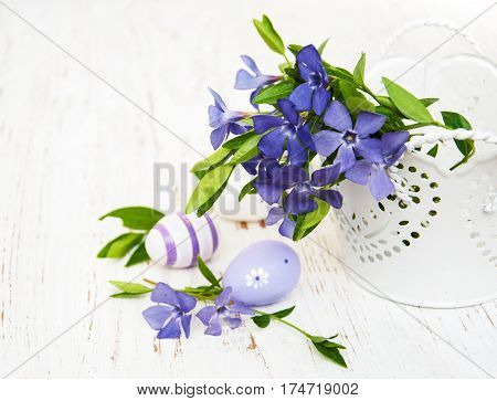 Bucket With  Periwinkle And Easter Eggs