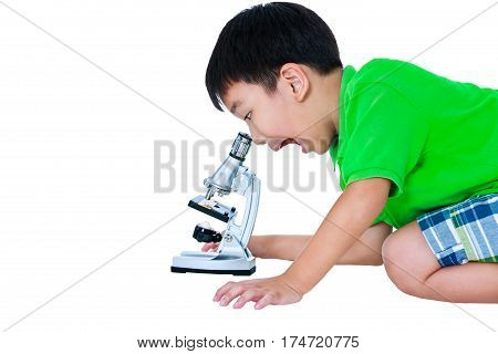 Asian Child Observed Through A Microscope Biological Preparations.