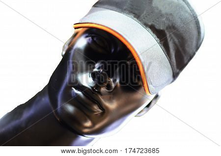 a mannequin in a cap on white background