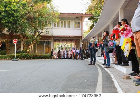 Chiang Mai Thailand - March 4, 2017: People are standing in respect for the flag ceremony rehearsal graduate