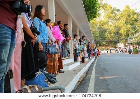 Chiang Mai Thailand - March 4 , 2017 : People are standing in respect for the flag ceremony rehearsal graduate
