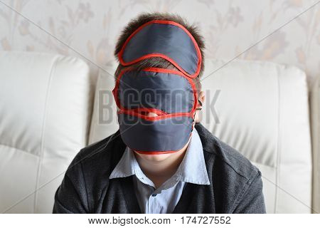 Portrait of a teenager with a few masks for sleeping on the face