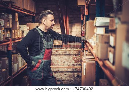 Storekeeper near shelves on a warehouse