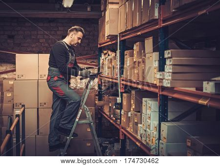 Storekeeper with manual picking list on a warehouse