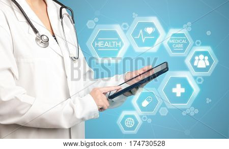 Female doctor holding tablet with blue background