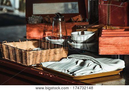 tea pot, cup and tea on a table.