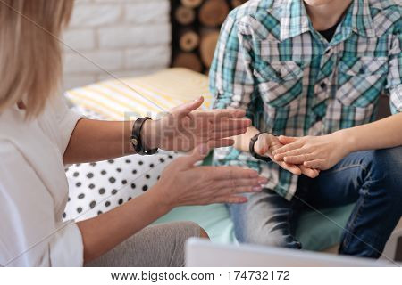 Use it. Female hands being parallel to each other in the air while showing something during discussion
