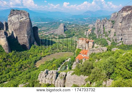 View of rock formations of the Meteora with Monastery of Roussanou and St. Nicholas Anapausa. Meteora Plain of Thessaly Greece Europe
