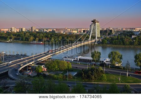 View on New bridge over Danube river from castle hill in BratislavaSlovakia at sunset