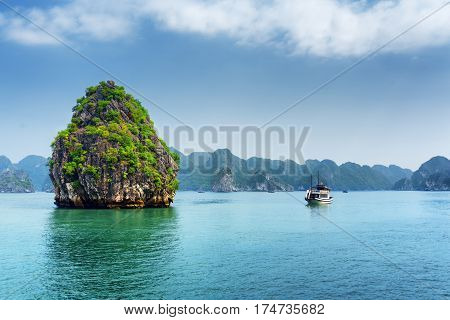 Scenic Karst Isle And Tourist Boat In The Ha Long Bay, Vietnam