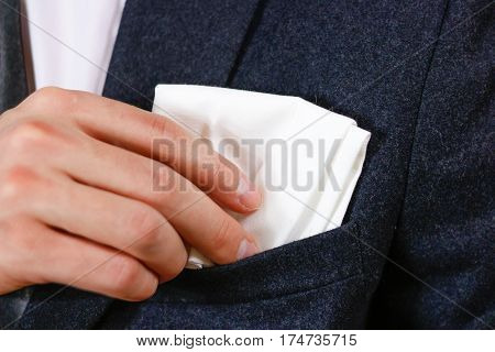 Close Up Hand Puts A White Handkerchief In The Pocket Of His Black Jacket