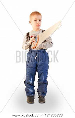 Boy child with the building tool. Isolated on white background. The child worker the Builder. Saws with a saw. Holding the hand saw